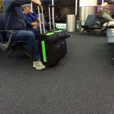 Hah. I am not the only person who realized that bright green duct tape is great for marking luggage.